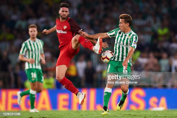 Sergi Gomez of Sevilla FC competes for the ball with Sergio Canales of Real Betis Balompie during the La Liga match between Real Betis Balompie and...