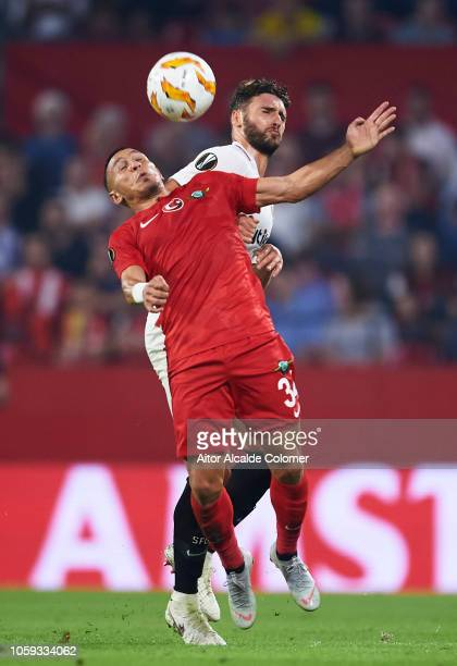 Sergi Gomez of Sevilla FC duels for the ball with Adrien Regattin of Akhisar Belediyespor during the UEFA Europa League Group J match between Sevilla...