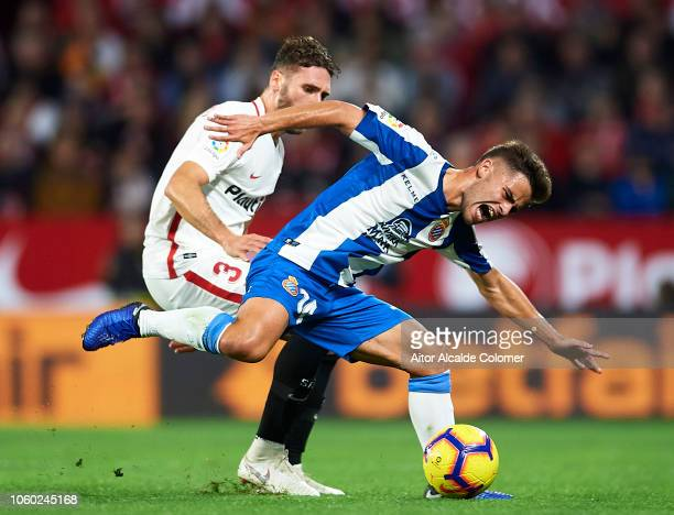 Sergi Gomez of Sevilla FC duels for the ball with Oscar Melendo of RCD Espanyol during the La Liga match between Sevilla FC and RCD Espanyol at...
