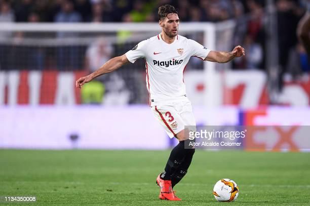 Sergi Gomez of Sevilla FC runs with the ball during the UEFA Europa League Round of 16 First Leg match between Sevilla and Slavia Prague at Estadio...