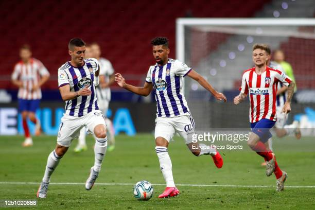 Sergi Guardiola and Matheus Fernandes of Valladolid in action during the La Liga match between Atletico de Madrid and Real Valladolid CF at Wanda...