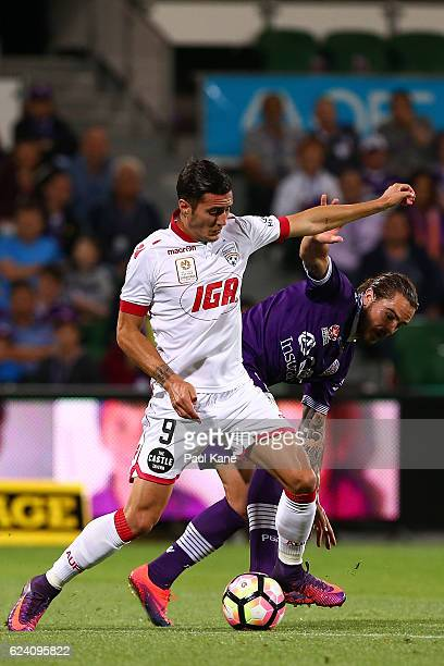 Sergi Guardiola of Adelaide and Josh Risdon of the Glory contest for the ball during the round seven ALeague match between the Perth Glory and...