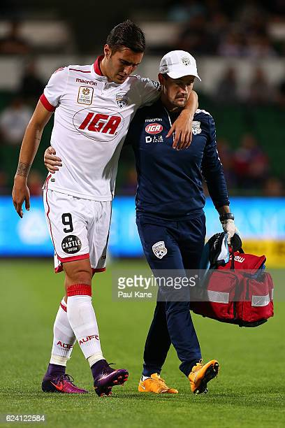 Sergi Guardiola of Adelaide is assisted from the field during the round seven ALeague match between the Perth Glory and Adelaide United at nib...