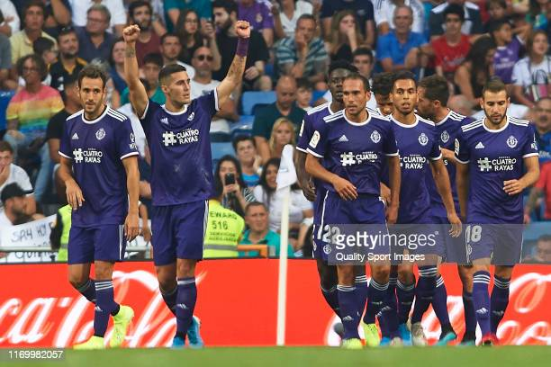 Sergi Guardiola of Real Valladolid celebrates after scoring his team's first goal with his teammates during the Liga match between Real Madrid CF and...