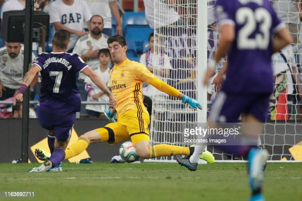 Sergi Guardiola of Real Valladolid scores the second goal to make it 11 Thibaut Courtois of Real Madrid during the La Liga Santander match between...