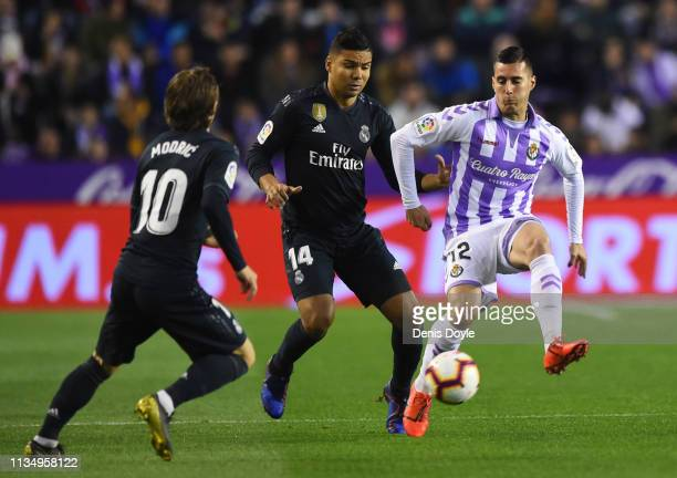 Sergi Guardiola of Real Valladolid takes on Casemiro and Luka Modric of Real Madrid during the La Liga match between Real Valladolid CF and Real...