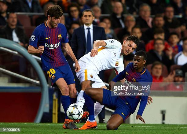 Sergi Roberto and Nelson Semedo of Barcelona compete for the ball with Lorenzo Pellegrini of Roma during the UEFA Champions League Quarter Final Leg...