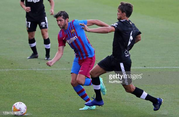 Sergi Roberto and Ribelles during the friendly match between FC Barcelona and Club Gimnastic de Tarragona, played at the Johan Cruyff Stadium on 21th...