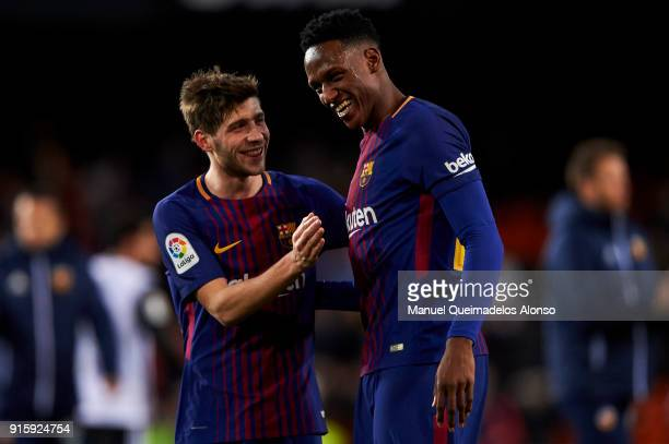 Sergi Roberto and Yerry Mina of FC Barcelona celebrate the victory at the end of the Copa de Rey semifinal second leg match between Valencia and...