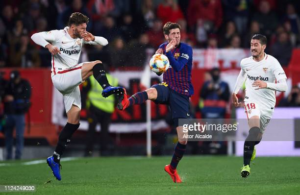 Sergi Roberto Carnicer of FC Barcelona competes for the ball with Sergi Gomez of Sevilla FC during the Copa del Quarter Final match between Sevilla...