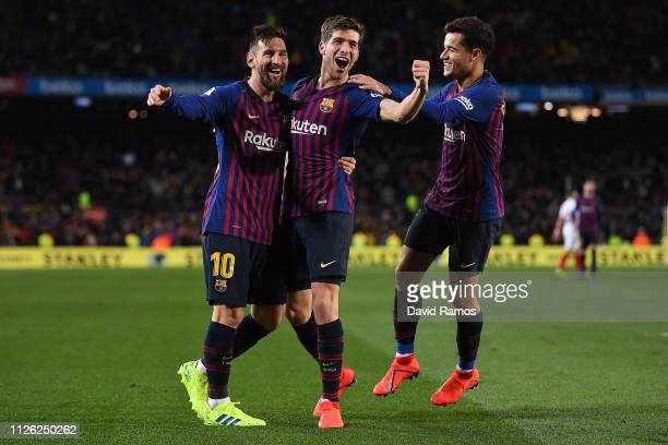 Sergi Roberto celebrates with Lionel Messi and Philippe Coutinho after scoring the fourth goal during the Copa del Rey Quarter Final second leg match...
