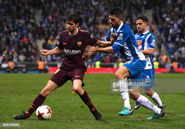 Sergi Roberto of Barcelona and Didac of Espanyol in action during the Spanish Copa del Rey Quarter Final First Leg match between Espanyol and...