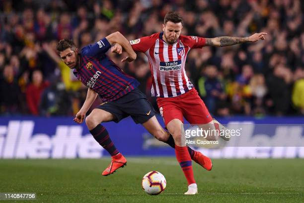 Sergi Roberto of Barcelona and Saul Niguez of Atletico Madrid battle for the ball during the La Liga match between FC Barcelona and Club Atletico de...