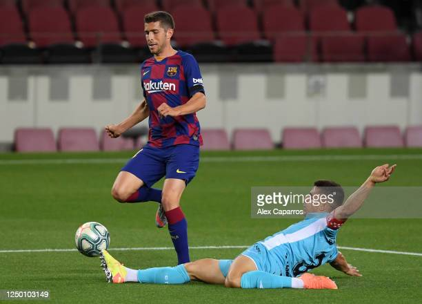 Sergi Roberto of Barcelona battles for possession with Roger Assale of Leganes during the Liga match between FC Barcelona and CD Leganes at Camp Nou...
