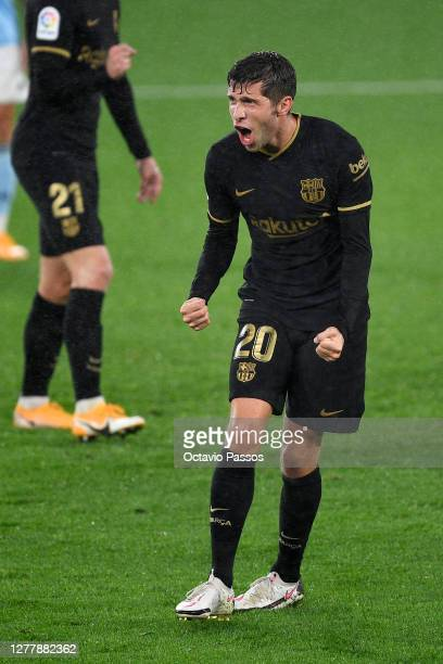 Sergi Roberto of Barcelona celebrates after scoring his team's third goal during the La Liga Santander match between RC Celta and FC Barcelona at...