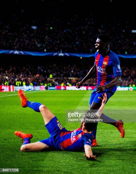 Sergi Roberto of Barcelona celebrates with his team mate Samuel Umiti after scoring his team's six and final goal during the UEFA Champions League...