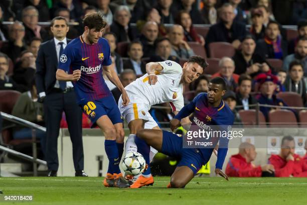 Sergi Roberto of Barcelona Nélson Semedo of Barcelona and Lorenzo Pellegrini of Rom battle for the ball during the UEFA Champions League QuarterFinal...