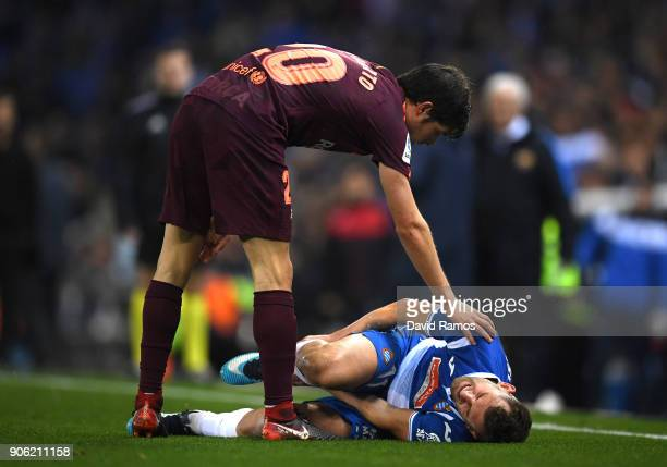 Sergi Roberto of Barcelona speaks with Leo Baptistao of Espanyol during the Spanish Copa del Rey Quarter Final First Leg match between Espanyol and...