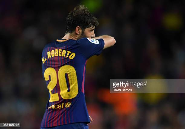 Sergi Roberto of Barcelona walks off the pitch as he is sent off during the La Liga match between Barcelona and Real Madrid at Camp Nou on May 6,...