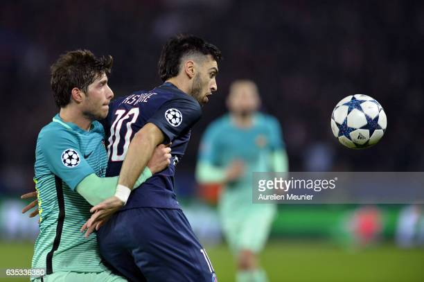 Sergi Roberto of FC Barcelona and Javier Pastore of Paris-Saint Germain fight for the ball during the UEFA Champions League Round of 16 first leg...