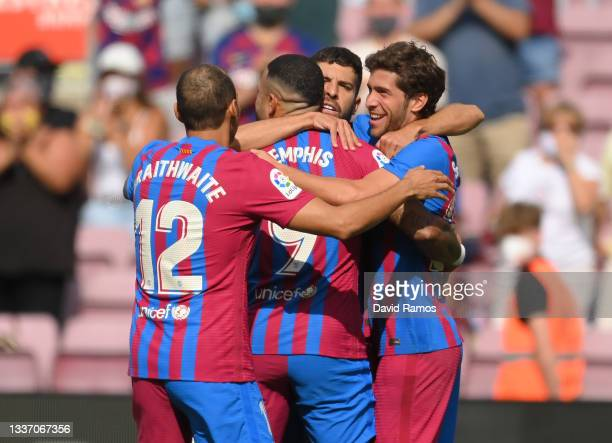 Sergi Roberto of FC Barcelona celebrates after scoring their sides first goal with team mates Martin Braithwaite and Memphis Depay during the La Liga...