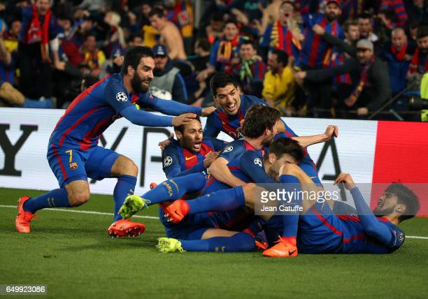 Sergi Roberto of FC Barcelona celebrates his winning goal with Arda Turan Luis Suarez Neymar Jr during the UEFA Champions League Round of 16 second...