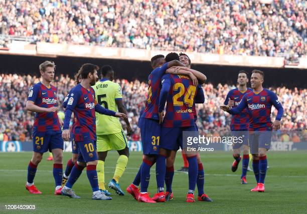 Sergi Roberto of FC Barcelona celebrates with teammates after scoring his team's second goal during the La Liga match between FC Barcelona and Getafe...