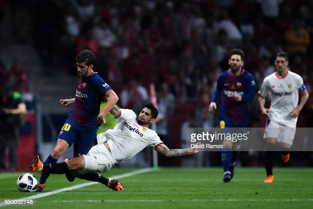Sergi Roberto of FC Barcelona competes for the ball with Ever Banega of Sevilla FC during the Spanish Copa del Rey Final match between Barcelona and...