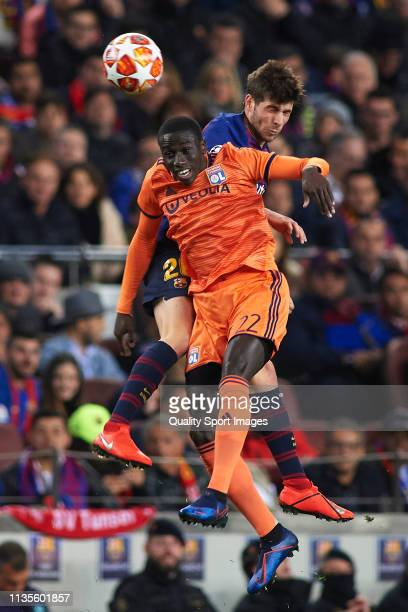 Sergi Roberto of FC Barcelona competes for the ball with Ferland Mendy of Olympique Lyonnais during the UEFA Champions League Round of 16 Second Leg...