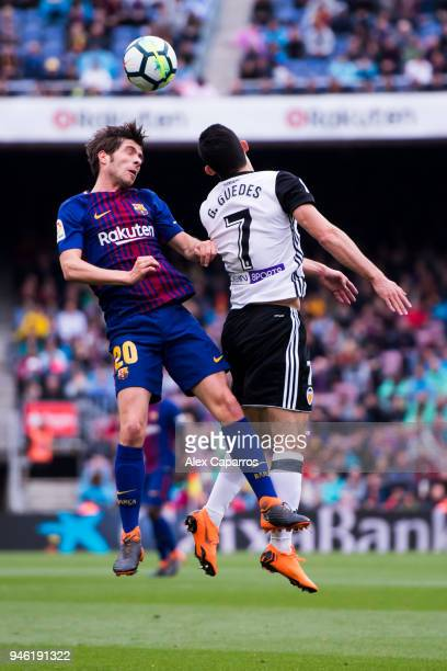 Sergi Roberto of FC Barcelona competes for the ball with Goncalo Guedes of Valencia CF during the La Liga match between Barcelona and Valencia at...