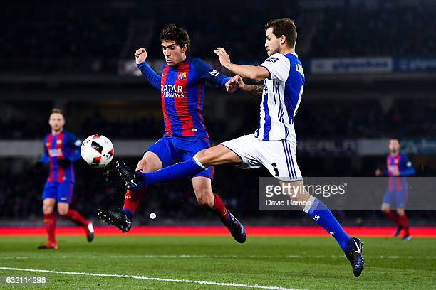Sergi Roberto of FC Barcelona competes for the ball with Inigo Martinez of Real Sociedad de Futbol during the Copa del Rey quarterfinal first leg...