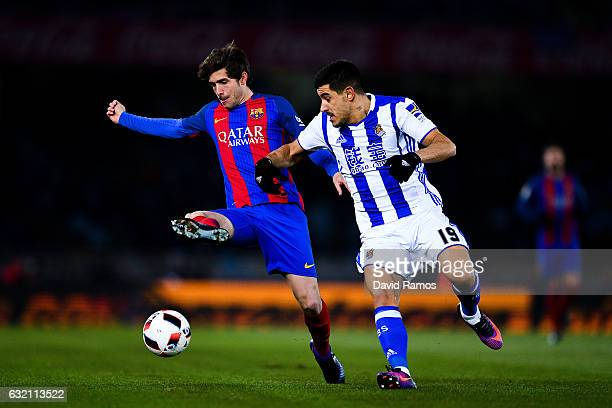 Sergi Roberto of FC Barcelona competes for the ball with Yuri Berchiche of Real Sociedad de Futbol during the Copa del Rey quarterfinal first leg...