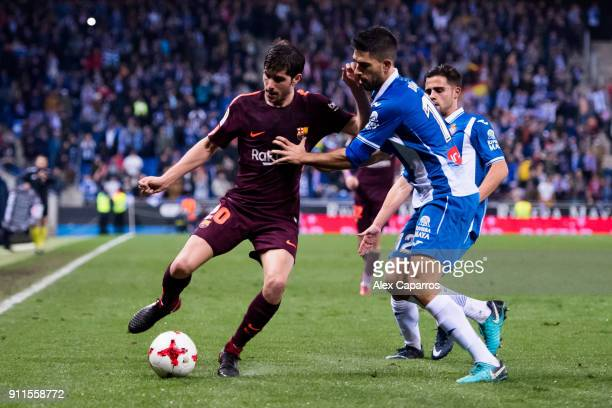 Sergi Roberto of FC Barcelona controls the ball under pressure from Didac Vila of RCD Espanyol during the Spanish Copa del Rey Quarter Final First...