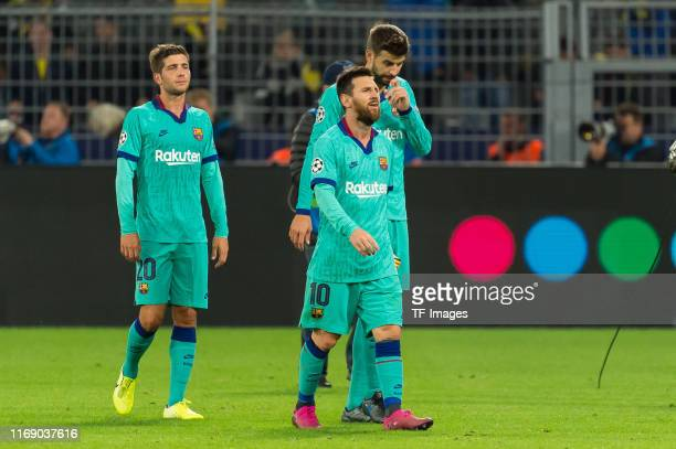 Sergi Roberto of FC Barcelona Lionel Messi of FC Barcelona and Gerard Pique of FC Barcelona looks dejected during the UEFA Champions League group F...
