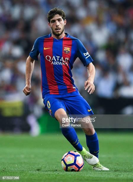 Sergi Roberto of FC Barcelona runs with the ball during the La Liga match between Real Madrid CF and FC Barcelona at the Santiago Bernabeu stadium on...