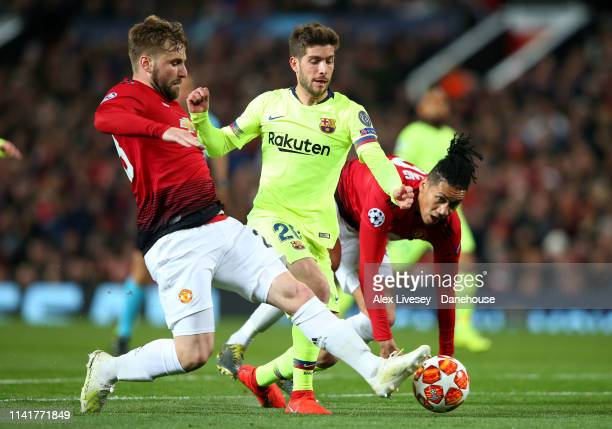 Sergi Roberto of FC Barcelona takes on Luke Shaw and Chris Smalling of Manchester United during the UEFA Champions League Quarter Final first leg...