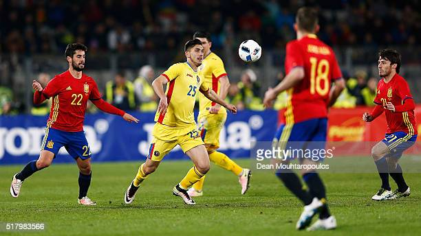 Sergi Roberto of Romania battles for the ball with Isco Jordi Alba and David Silva of Spain during the International Friendly match between Romania...