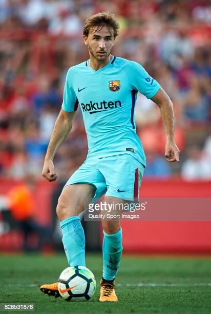 Sergi Samper of Barcelona in action during the preseason friendly match between Gimnastic de Tarragona and FC Barcelona at Nou Estadi de Tarragona on...