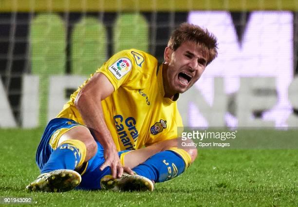 Sergi Samper of Las Palmas lies injured on the pitch during the La Liga match between Las Palmas and Eibar at Estadio Gran Canaria on January 6 2018...