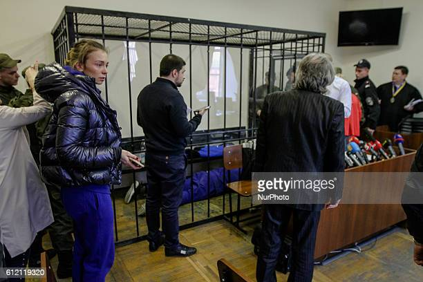 Sergii Kalinovskiy who is under investigation for a double murder committed eight years ago is seen lying on a floor inside a steel cage in a court...