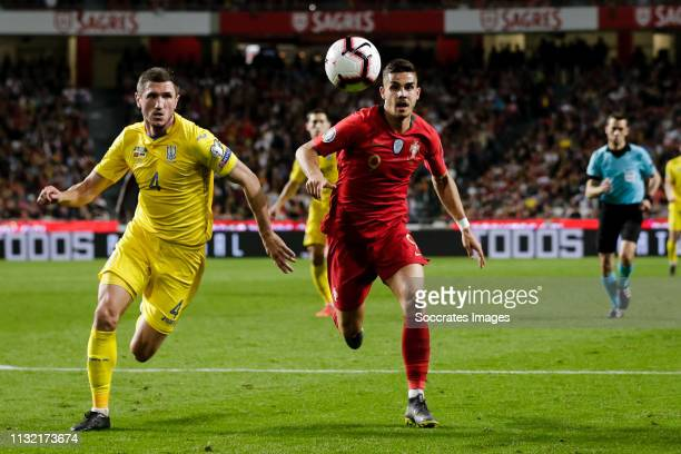 Sergii Kryvtsov of Ukraine Andre Silva of Portugal during the EURO Qualifier match between Portugal v Ukraine at the Estádio da Luz on March 22 2019...