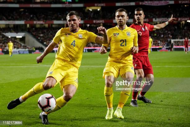 Sergii Kryvtsov of Ukraine Oleksandr Karavaev of Ukraine Andre Silva of Portugal during the EURO Qualifier match between Portugal v Ukraine at the...