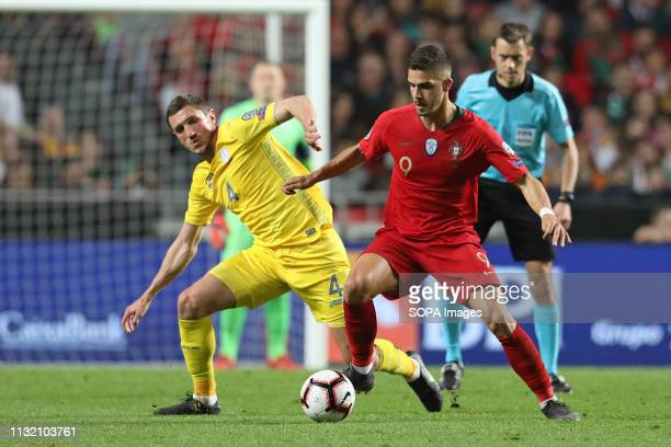 LUZ STADIUM LISBON PORTUGAL Sergii Kryvtsov of Ukraine vies for the ball with André Silva of Portugal during the Qualifiers Group B to Euro 2020...