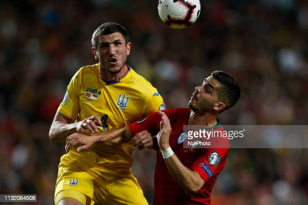 Sergii Kryvtsov of Ukraine vies for the ball with Andre Silva of Portugal during the Euro 2020 qualifying match football match between Portugal vs...