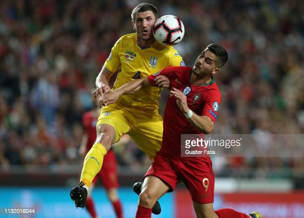 Sergii Kryvtsov of Ukraine with Andre Silva of Portugal and Sevilla FC in action during the UEFA Euro 2020 Qualifier match between Portugal and...