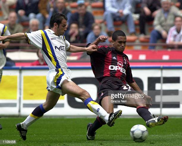 Serginho of AC Milan and Natale Gonnella of Verona in action during the SerieA 28th Round League match between AC Milan and Verona played at the San...