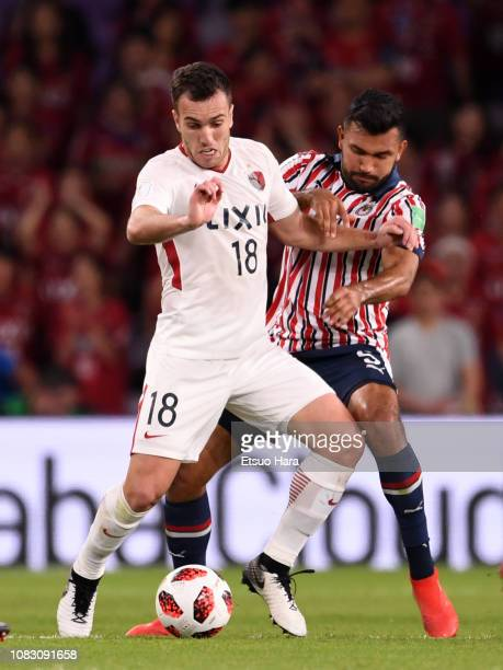 Serginho of Kashima Antlers and Hedgardo Marin of Guadalajara compete for the ball during the match between Kashima Antlers and CD Guadalajara on...