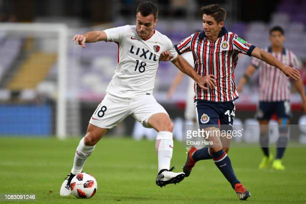 Serginho of Kashima Antlers and Isaac Brizuela of Guadalajara compete for the ball during the match between Kashima Antlers and CD Guadalajara on...