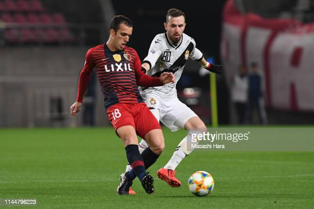 Serginho of Kashima Antlers and Jordon Mutch of Gyeongnam FC compete for the ball during the AFC Champions League Group E match between Kashima...