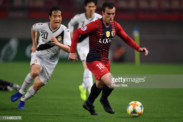 Serginho of Kashima Antlers and Kim Hyo Gi of Gyeongnam compete for the ball during the AFC Champions League Group E match between Kashima Antlers...